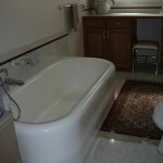Old bathroom with cast iron tub